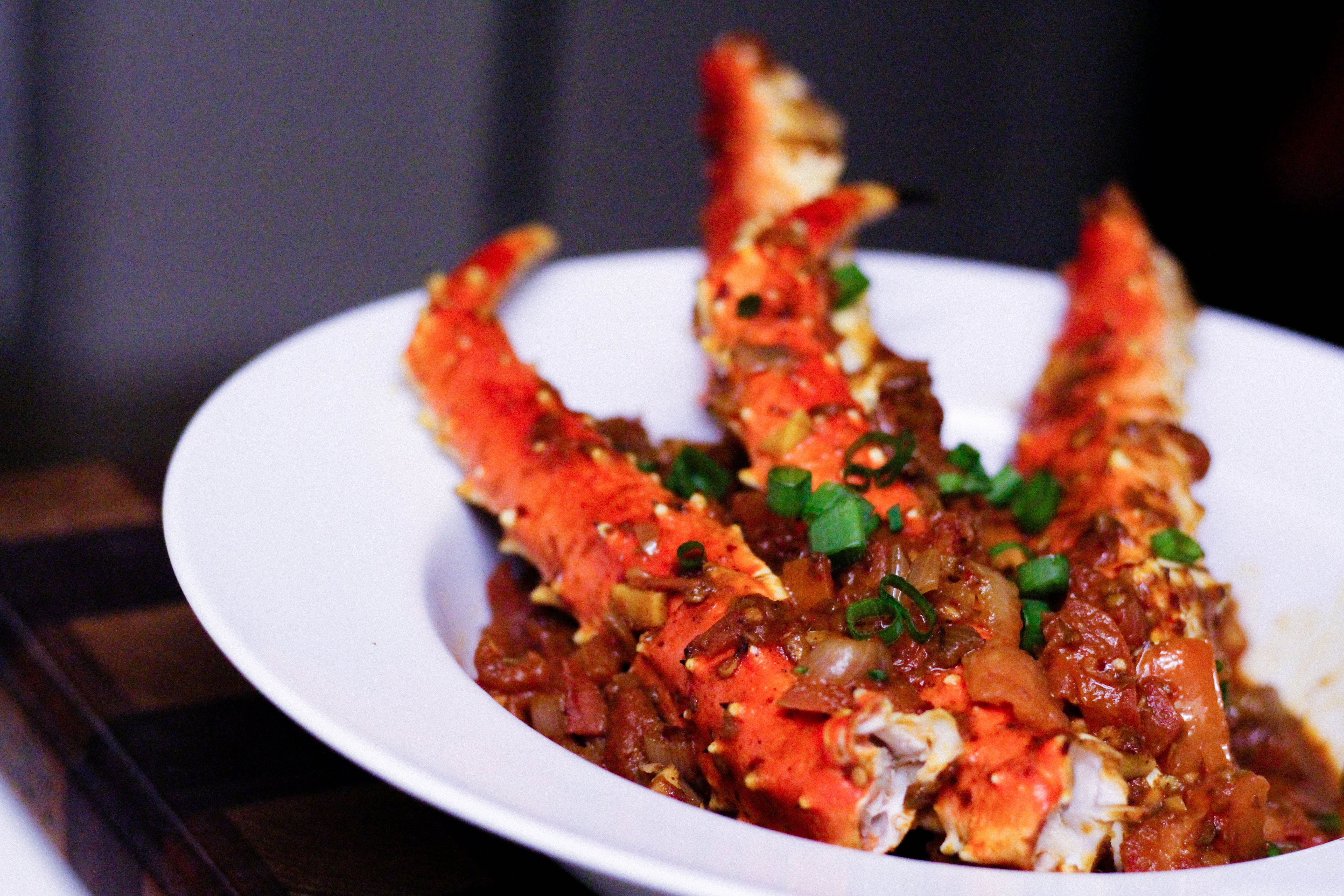 King Crab Legs with Spicy Ghanaian Shito and Tomato Sauce